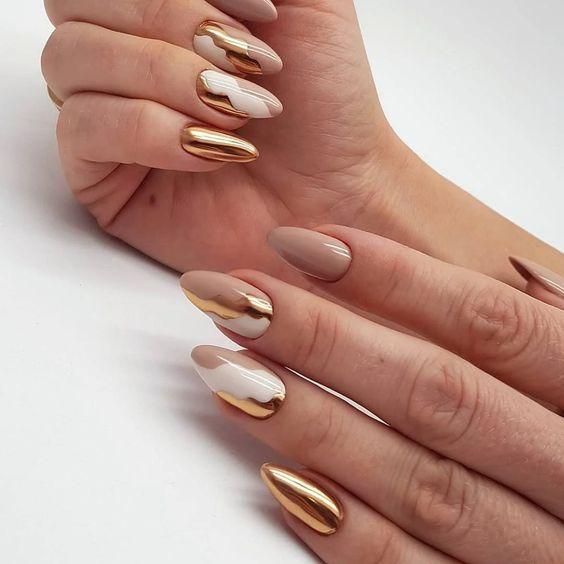Beige golden manicure
