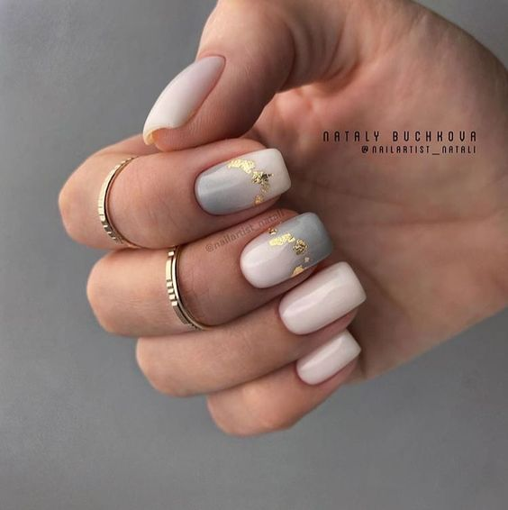 Beige nails with gray patterns