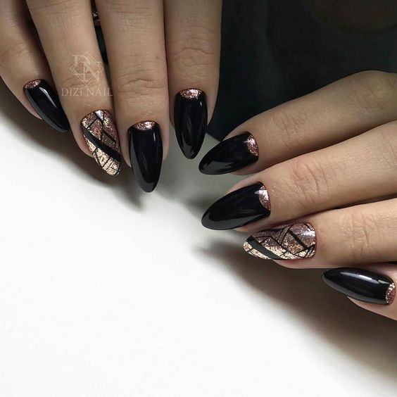 Black nails with golden patterns
