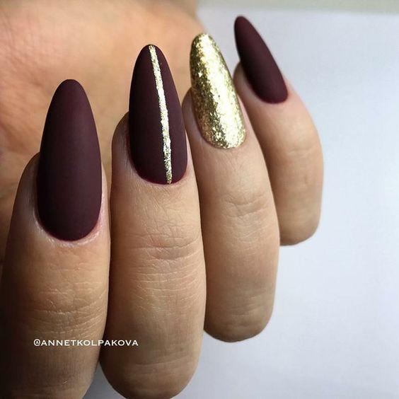 Burgundy golden nails