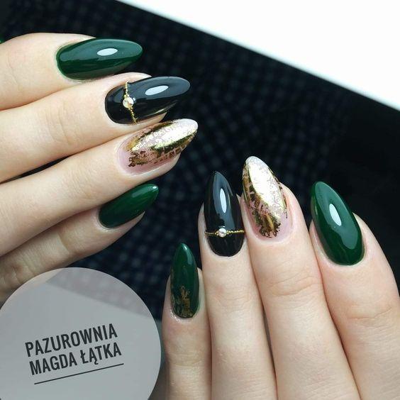 Dark green nails with golden patterns
