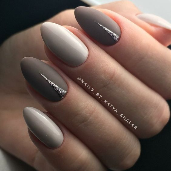 Gray manicure with silver patterns