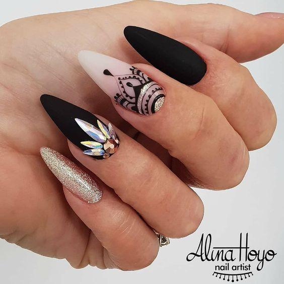Matte black nails with golden glitter