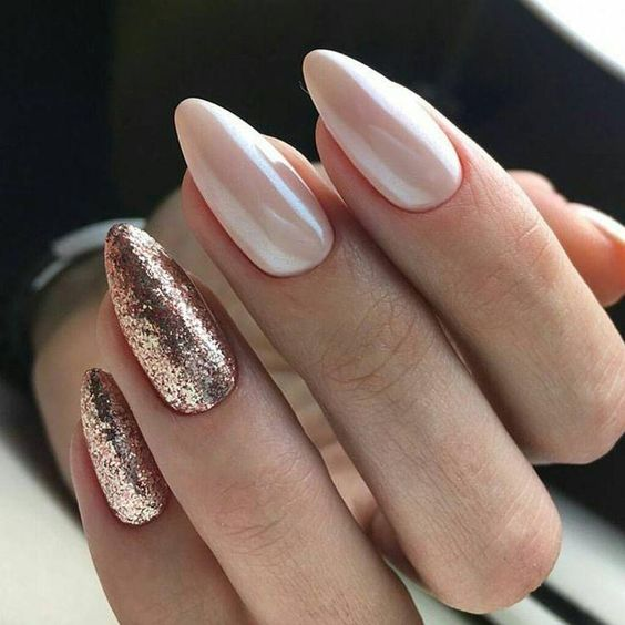 Pearl nails with golden glitter