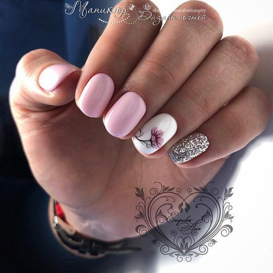 Light pink nails with flower patterns
