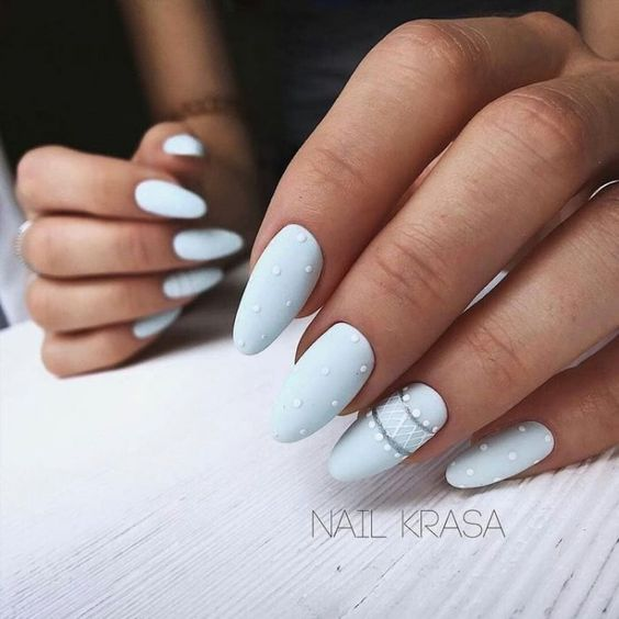 Matte blue nails with patterns