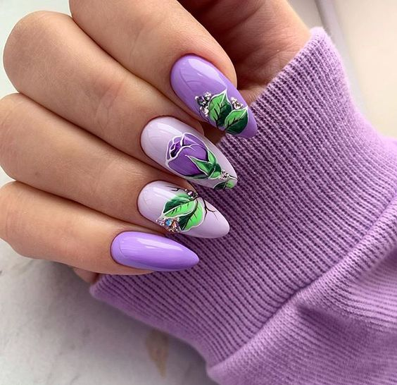Purple nails with flower patterns