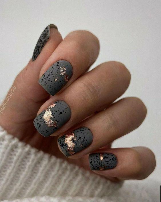 Short dark nails with golden foil