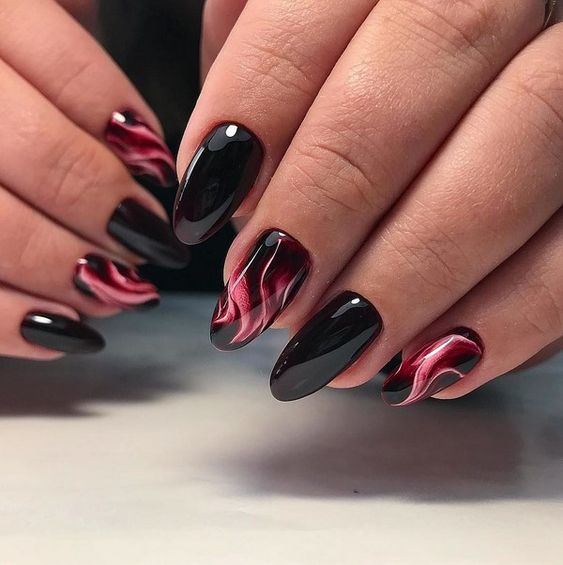 Black nails with cat eye effect