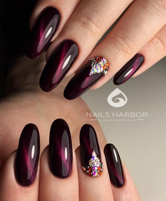 Burgundy cat eye nails