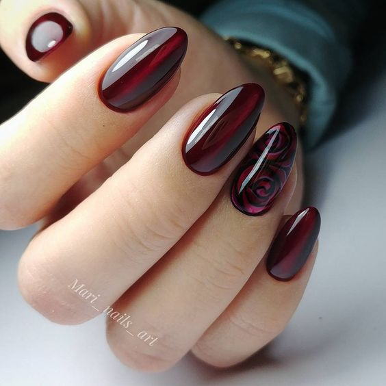 Dark red cat eye nails