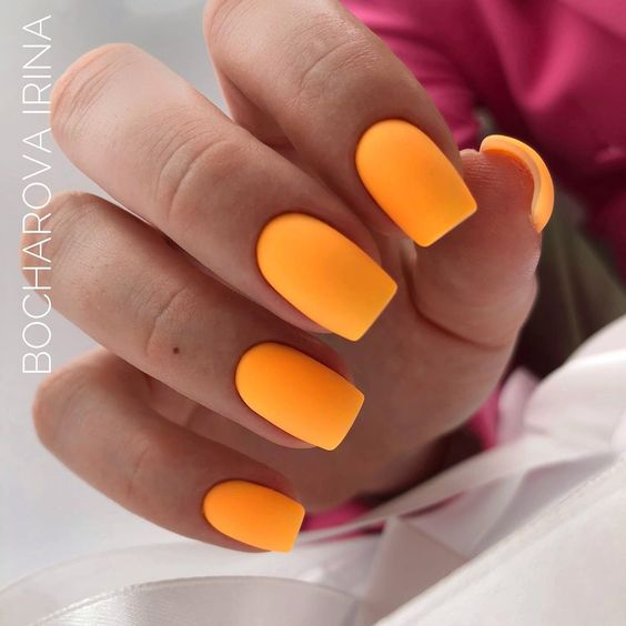 Matte orange manicure