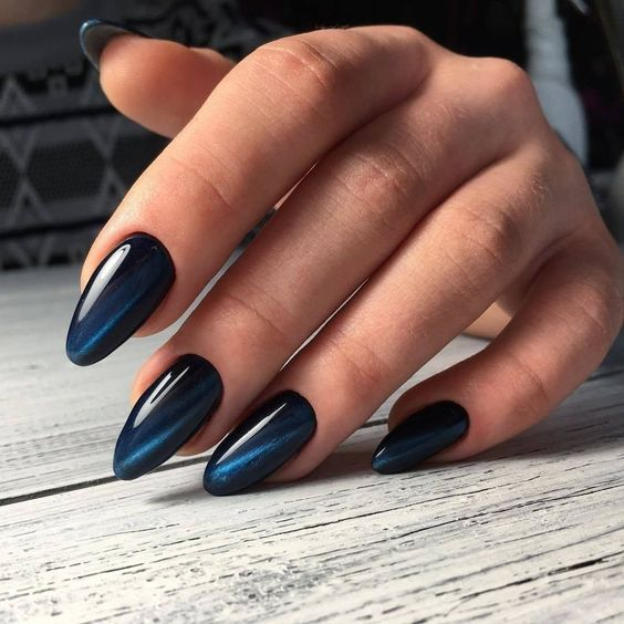 Navy blue cat eye nails