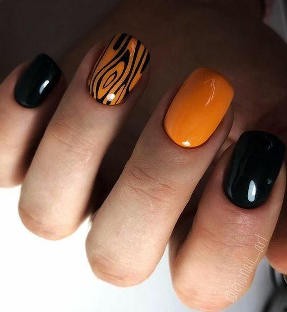 Orange and black nails