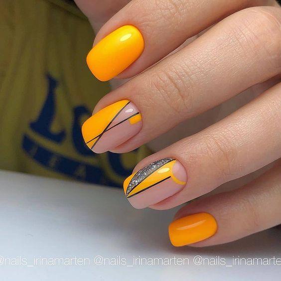 Orange manicure with geometric patterns