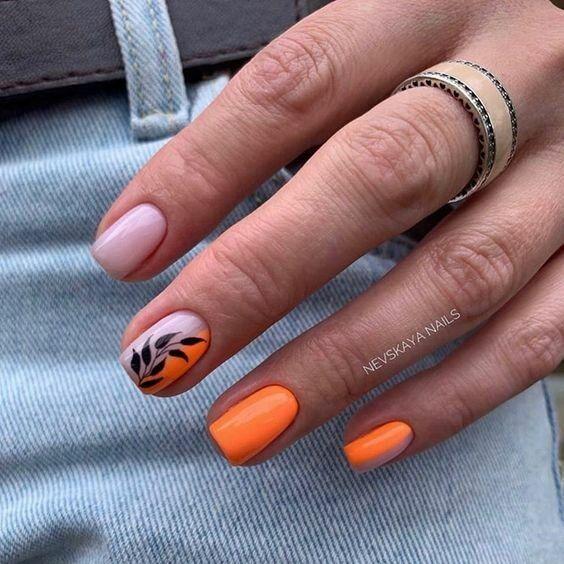 Orange manicure with patterns