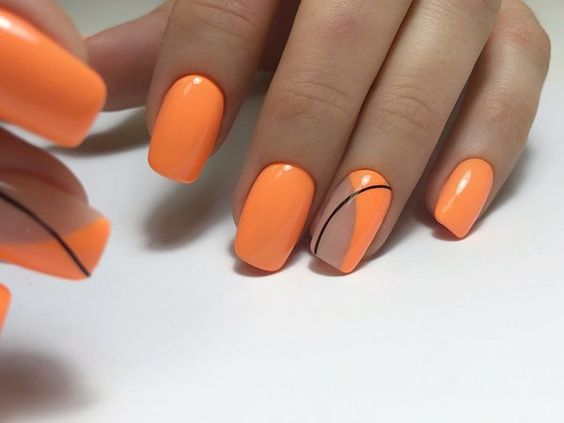 Orange nails with geometric patterns
