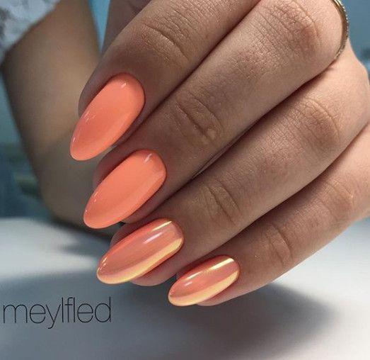 Orange nails with mermaid effect