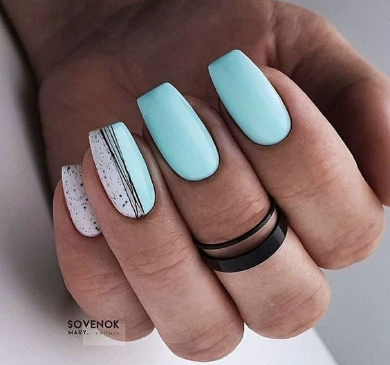 Pastel blue nails with patterns