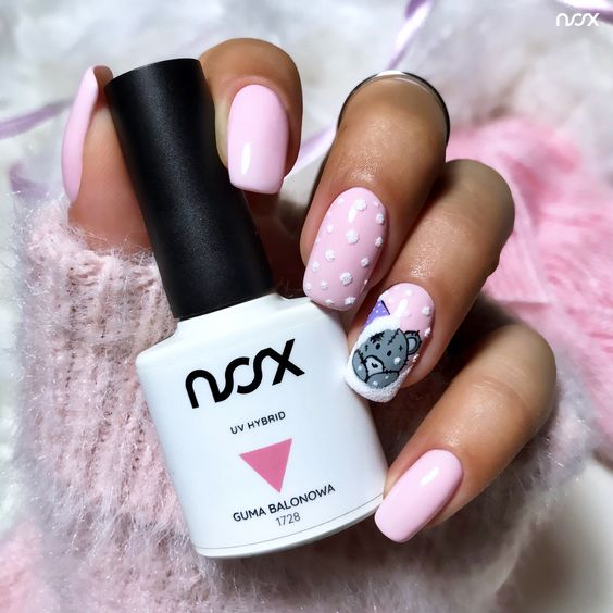 Pink pastel nails with patterns