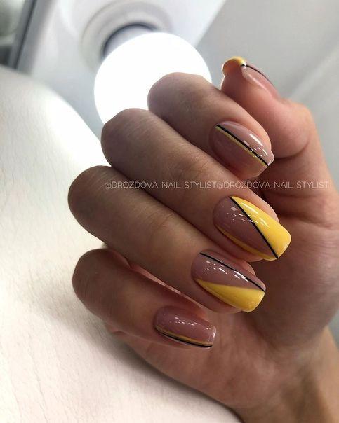 Yellow manicure with geometric patterns