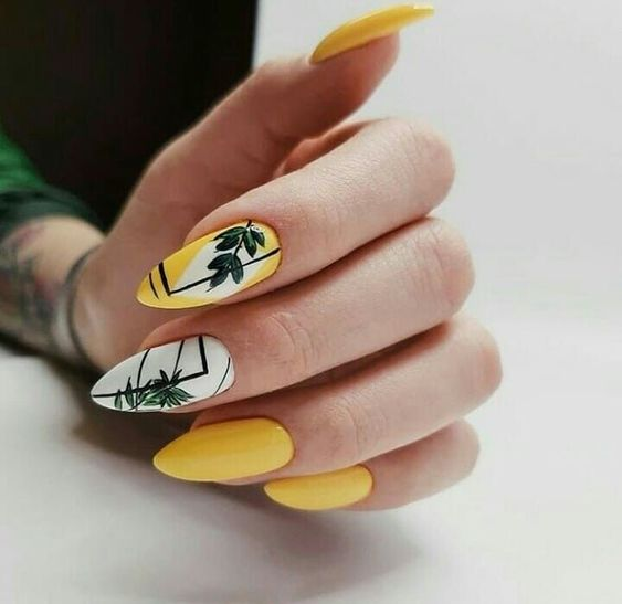 Yellow manicure with palm leaves