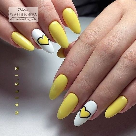 Yellow manicure with patterns