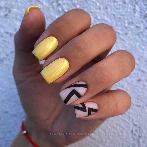 Yellow nails with geometric patterns