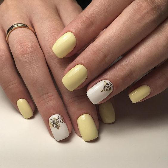 Yellow nails with patterns