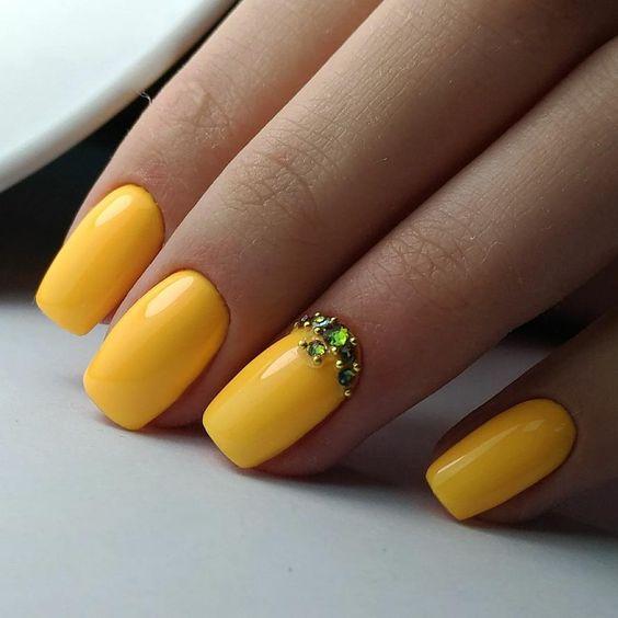 Yellow nails with rhinestones