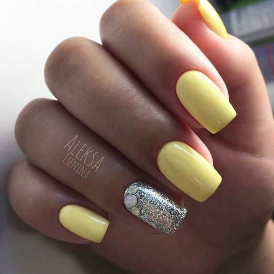 Yellow nails with silver glitter