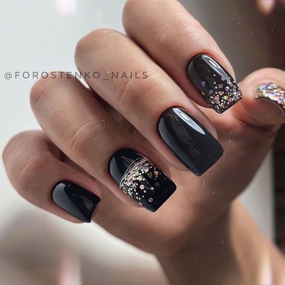 Black manicure with glitter
