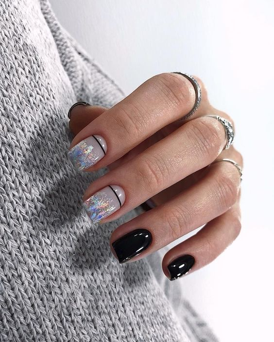Black manicure with patterns