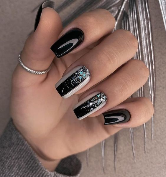 Black nails with patterns